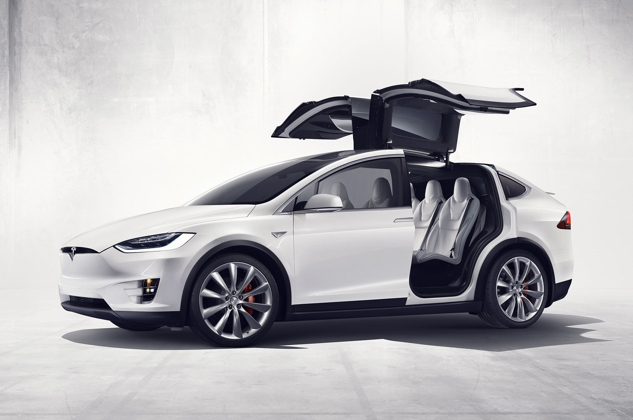 2016 Tesla Model X official photos front three quarter falcon door open